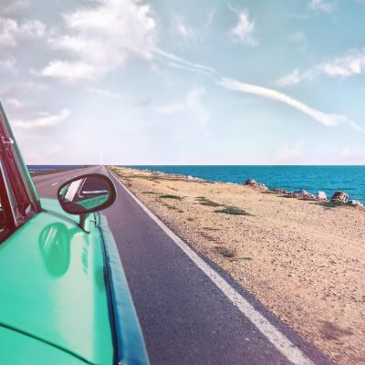 green-car-near-seashore-with-blue-ocean-1118448_1