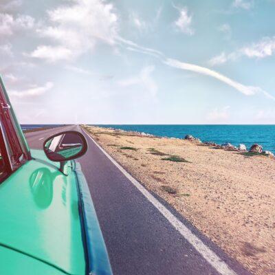 green-car-near-seashore-with-blue-ocean-1118448_1